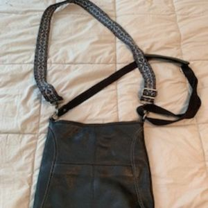 Lucia Crossbody by the Sak with guitar strap